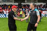 28 May 2017; Tyrone manager Mickey Harte, left, shakes hands with Derry manager Damian Barton following the Ulster GAA Football Senior Championship Quarter-Final match between Derry and Tyrone at Celtic Park in Derry. Photo by Ramsey Cardy/Sportsfile
