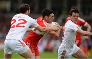 28 May 2017; Danny Heavron of Derry in action against Ronan McNabb , left, and Aidan McCrory of Tyrone during the Ulster GAA Football Senior Championship Quarter-Final match between Derry and Tyrone at Celtic Park, in Derry. Photo by Oliver McVeigh/Sportsfile