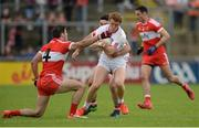 28 May 2017; Peter Harte of Tyrone in action against Karl McKaigue, left, and Danny Heavron of Derry during the Ulster GAA Football Senior Championship Quarter-Final match between Derry and Tyrone at Celtic Park, in Derry. Photo by Oliver McVeigh/Sportsfile
