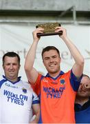 28 May 2017; St Patrick's captain Eoghan O'Mahony lifts the shield after the Leinster Adult Club Hurling League Division 4 Final match between Ballyboden St Enda's and St Patrick's at O'Connor Park in Tullamore, Co Offaly. Photo by Piaras Ó Mídheach/Sportsfile