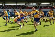 28 May 2017; Clare players including Keelan Sexton and Gary Brennan break away from the traditional pre-match team photograph ahead of the Munster GAA Football Senior Championship Quarter-Final between Clare and Limerick at Cusack Park in Ennis, Co. Clare. Photo by Diarmuid Greene/Sportsfile