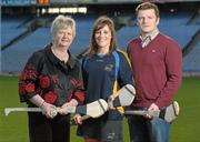 19 December 2011; At the announcement of the National Camogie Third Level Bursaries is recipient Laura Twomey, DCU and Naomh Mearnog Camogie Club, Co. Dublin, with President of the Camogie Association Joan O'Flynn, left, and Shane D'Arcy, Comhairle Comógaíochta Ard-Oideachais. Croke Park, Dublin. Picture credit: Paul Mohan / SPORTSFILE