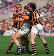 16 August 1998; Billy O'Sullivan of Waterford in action against Canice Brennan, left, and Willie O'Connor of Kilkenny during the Guinness All-Ireland Senior Hurling Championship Semi-Final match between Kilkenny and Waterford at Croke Park in Dublin. Photo by Damien Eagers/Sportsfile