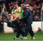 11th October 1998; Brian Stynes, Ireland, is carried off the field by Ronan Carolan Team Physio, left, and Dr Jack Finn, team doctor. Ireland v Australia, International Rules Series, Croke Park. Picture credit: Ray McManus / SPORTSFILE