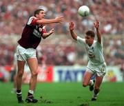 27th September 1998. Galway's Kevin Walsh gets a handpass away despite the attentions of Kildare's Eddie McCormack. All Ireland Football Final, Croke Park, Dublin. Picture Credit: Ray McManus/SPORTSFILE.