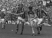25 July 1982; Padraig Horan of Offaly in action against John Henderson, left, and Brian Cody of Kilkenny during the Leinster Senior Hurling Championship Final match between Kilkenny and Offaly at Croke Park in Dublin.