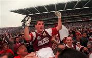 27 September 1998; Tomás Meehan of Galway celebrates with supporters after the Bank of Ireland All-Ireland Senior Football Championship Final match between Kildare and Galway at Croke Park in Dublin. Photo by Ray McManus/Sportsfile