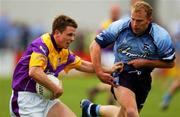 1 June 2002; Diarmuid Kinsella, Wexford, is tackled by Dublin's Shane Ryan. Dublin v Wexford, Bank of Ireland, Leinster Football Championship, Dr. Cullen Park, Carlow. Football. Picture credit; Damien Eagers / SPORTSFILE *EDI*