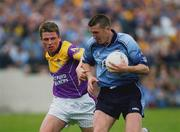 1 June 2002; Darren Homan, Dublin, is tackled by Wexford's Diarmuid Kinsella. Bank of Ireland Leinster Football Championship First Round, Dublin v Wexford, Dr Cullen Park, Carlow. Picture credit; Matt Browne / SPORTSFILE *EDI*