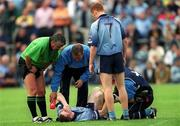 1 June 2002; Coman Goggins lies injured on the ground as his team-mate Peadar Andrews, (7) and referee Brian Crowe look on, Dublin v Wexford, Bank of Ireland, Leinster Football Championship, Dr. Cullen Park, Carlow. Football. Picture credit; Damien Eagers / SPORTSFILE