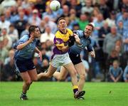 1 June 2002; Redmond Barry, Wexford in action against Jonathan Magee, (left) and Peadar Andrews, Dublin, Dublin v Wexford, Bank of Ireland, Leinster Football Championship, Dr. Cullen Park, Carlow. Football. Picture credit; Damien Eagers / SPORTSFILE