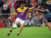 1 June 2002; Matty Forde, Wexford in action against Paul Casey, Dublin, Dublin v Wexford, Bank of Ireland, Leinster Football Championship, Dr. Cullen Park, Carlow. Football. Picture credit; Damien Eagers / SPORTSFILE