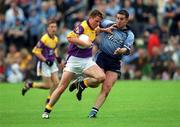 1 June 2002; Diarmuid Kinsella, Wexford in action against Jonathan Magee, Dublin, Dublin v Wexford, Bank of Ireland, Leinster Football Championship, Dr. Cullen Park, Carlow. Football. Picture credit; Damien Eagers / SPORTSFILE