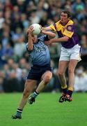 1 June 2002; Jonathan Magee, Dublin in action against Jack Berry, Wexford, Dublin v Wexford, Bank of Ireland, Leinster Football Championship, Dr. Cullen Park, Carlow. Football. Picture credit; Damien Eagers / SPORTSFILE