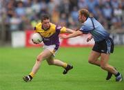 1 June 2002; David Murphy, Wexford, is tackled by Dublin's Shane Ryan.  Dublin v Wexford, Bank of Ireland, Leinster Football Championship, Dr. Cullen Park, Carlow. Football. Picture credit; Damien Eagers / SPORTSFILE
