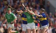 2 June 2002; Mark Keane, Limerick, is tackled by Donnacha Fahy, left, and Thomas Costello, Tipperary. Limerick v Tipperary, Munster Senior Hurling Championship Semi-Final, Pairc Ui Chaoimh, Cork. Picture credit; Brendan Moran / SPORTSFILE