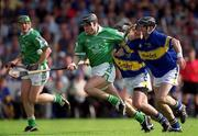2 June 2002; Mark Keane, Limerick, is tackled by Thomas Costello, left, and Donnacha Fahy, Tipperary. Limerick v Tipperary, Munster Senior Hurling Championship Semi-Final, Pairc Ui Chaoimh, Cork. Picture credit; Brendan Moran / SPORTSFILE