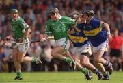 2 June 2002; Mark Keane, Limerick, in action against Thomas Costello, right, and Donnacha Fahy, Tipperary. Tipperary v Limerick, Munster Hurling Championship Semi-Final, Pairc Ui Chaoimh, Cork. Picture credit; Brendan Moran / SPORTSFILE