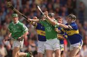 2 June 2002; Mark Keane, Limerick, in action against Donnacha Fahy, left, and Thomas Costello,Tipperary. Tipperary v Limerick, Munster Hurling Championship Semi-Final, Pairc Ui Chaoimh, Cork. Picture credit; Brendan Moran / SPORTSFILE