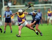 9 June 2002; Wexford's Paul Codd is tackled by Conal Keaney, Dublin. Wexford v Dublin, Leinster Senior Hurling Championship Semi-finals, Semple Stadium, Thurles, Tipperary. Picture credit; Ray McManus / SPORTSFILE
