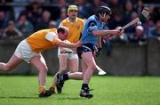 Brian McMahon, Dublin pulls away from the clutches of Terence McNaughton, Antrim. Dublin v Antrim. 11/5/97. Photograph: Ray McManus SPORTSFILE.