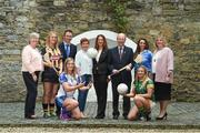6 June 2017; Minister for Transport, Tourism and Sport, Shane Ross with Patrick O'Donovan TD, Minister of State for Tourism and Sport who were joined by from left Camogie Association CEO, Joan O'Flynn, WGPA President, Aoife Lane, Sinead McNulty from DIT, Ladies Gaelic Football Players Ellen McCarron from Monaghan and Niamh Lister from Meath and Camogie players Edwina Keane from Kilkenny and Ali Twomey from Dublin and LGFA President, Marie Hickey, were all present to announce funding to the value of €428,000 which will be provided to adult intercounty Camogie and Ladies Gaelic Football teams in the coming weeks. €500,000 worth of funding will be provided in 2017 and again in 2018. The funding, which will be distributed through Sport Ireland, was agreed following a joint proposal by the Camogie Association, the LGFA and the WGPA . Wilson Hartnell, Ely Place, Dublin. Photo by Matt Browne/Sportsfile