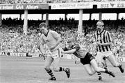 21 July 1991; Kilkenny goalkeeper Michael Walsh, supported by team-mate John Henderson, clears under pressure from Brian McMahon, Dublin. Leinster Senior Hurling Championship Final, Dublin v Kilkenny, Croke Park, Dublin. Picture credit; Connolly Collection / SPORTSFILE