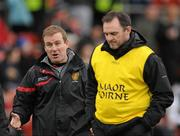 8 January 2012; Down manager James McCartan, left, in discusson with his assistant manager Aidan O'Rourke as they come off at half time. Dr. McKenna Cup, Section B, Down v Armagh, Pairc Esler, Newry, Co. Down. Picture credit: Oliver McVeigh / SPORTSFILE