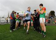 8 January 2012; Carlow players provide a guard of honour for Dublin players, the reigning All-Ireland Champions, including Declan Lally, ahead of the game. Bord Na Mona O'Byrne Cup, First Round, Carlow v Dublin, Dr. Cullen Park, Carlow. Picture credit: Stephen McCarthy / SPORTSFILE