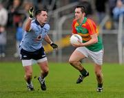 8 January 2012; Ed Finnegan, Carlow, in action against Declan Lally, Dublin. Bord Na Mona O'Byrne Cup, First Round, Carlow v Dublin, Dr. Cullen Park, Carlow. Picture credit: Stephen McCarthy / SPORTSFILE