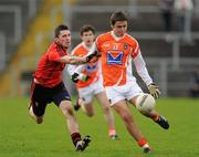 8 January 2012; Stefan Campbell, Armagh, in action against Keith Quinn, Down. Dr. McKenna Cup, Section B, Down v Armagh, Pairc Esler, Newry, Co. Down. Picture credit: Oliver McVeigh / SPORTSFILE