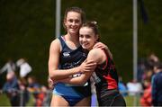 3 June 2017; Ciara Neville of Castletroy College, Co Limerick, embraces Aoife Lynch of Luttrellstown, Co Dublin, after winning the Senior Girl's 100m during the Irish Life Health All Ireland Schools Track & Field Championships 2017 at Tullamore Harrier Stadium, in Co. Offaly. Photo by Sam Barnes/Sportsfile