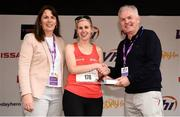5 June 2017; Visually impaired runner Sinead Kane, centre, is presented with her prize by Vhi CEO John O'Dwyer, right, and Kathy Endersen, left, CEO of the Vhi Women's Mini Marathon, after finishing first in her category. Nearly 33,000 participants took to the streets of Dublin to run, walk and jog the 10km route, raising much needed funds for hundreds of charities around the country. For further information please log on to www.vhiwomensminimarathon.ie  Photo by Seb Daly/Sportsfile