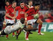 14 January 2012; Lifeimi Mafi, Munster, is tackled by Ibrahim Diarra, Castres Olympique. Heineken Cup, Pool 1, Round 5, Munster v Castres Olympique, Thomond Park, Limerick. Picture credit: Matt Browne / SPORTSFILE - read more