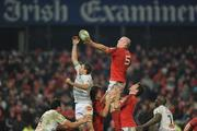 14 January 2012; Paul O'Connell, Munster, wins possession for his side in a lineout ahead of Yannick Caballero, Castres Olympique. Heineken Cup, Pool 1, Round 5, Munster v Castres Olympique, Thomond Park, Limerick. Picture credit: Matt Browne / SPORTSFILE - read more
