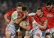 14 January 2012; Peter O'Mahony, Munster, is tackled by Yannick Caballero, left, and Pierre Bernard, Castres Olympique. Heineken Cup, Pool 1, Round 5, Munster v Castres Olympique, Thomond Park, Limerick. Picture credit: Diarmuid Greene / SPORTSFILE - read more