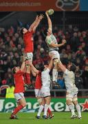 14 January 2012; Matthias Rolland, Castres Olympique, wins possession for his side in the line-out ahead of Donnacha Ryan, Munster. Heineken Cup, Pool 1, Round 5, Munster v Castres Olympique, Thomond Park, Limerick. Picture credit: Diarmuid Greene / SPORTSFILE