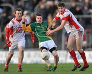 15 January 2012; Donnacha Tobin, Meath, in action against Brian Donnelly, right and Mark Brennan, Louth. Bord na Mona O'Byrne Cup, Quarter-Final, Meath v Louth, Pairc Tailteann, Navan, Co. Meath. Picture credit: David Maher / SPORTSFILE