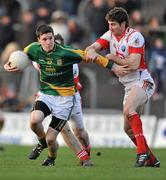 15 January 2012; Donnacha Tobin, Meath, in action against Brian Donnelly, Louth. Bord na Mona O'Byrne Cup, Quarter-Final, Meath v Louth, Pairc Tailteann, Navan, Co. Meath. Picture credit: David Maher / SPORTSFILE