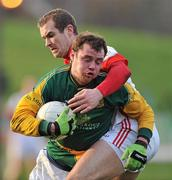 15 January 2012; Cormac McGuinness, Meath, in action against Paddy Keenan, Louth. Bord na Mona O'Byrne Cup, Quarter-Final, Meath v Louth, Pairc Tailteann, Navan, Co. Meath. Picture credit: David Maher / SPORTSFILE