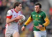 15 January 2012; Brian Donnelly, Louth, in action against Brian Meade, Meath. Bord na Mona O'Byrne Cup, Quarter-Final, Meath v Louth, Pairc Tailteann, Navan, Co. Meath. Picture credit: David Maher / SPORTSFILE
