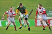 15 January 2012; Mark Ward, Meath, in action against Ray Finnegan, left, and Paddy Keenan, Louth. Bord na Mona O'Byrne Cup, Quarter-Final, Meath v Louth, Pairc Tailteann, Navan, Co. Meath. Picture credit: David Maher / SPORTSFILE