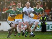 15 January 2012; James Kavanagh, Kildare, in action against James Gallagher, left, Richie Dalton, and Ross Brady, right, Offaly. Bord na Mona O'Byrne Cup, Quarter-Final, Kildare v Offaly, St Conleth's Park, Newbridge, Co. Kildare. Picture credit: Dáire Brennan / SPORTSFILE