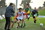 15 January 2012; Derek Crilly, Louth, in action against Shane McAnarney, Meath, as the Meath manager Seamus McEnaney looks on. Bord na Mona O'Byrne Cup, Quarter-Final, Meath v Louth, Pairc Tailteann, Navan, Co. Meath. Picture credit: David Maher / SPORTSFILE