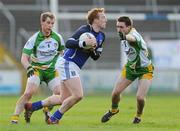 15 January 2012; Declan McKiernan, Cavan, in action against Martin Reilly and Anthony Thompson, left, Donegal. Power NI Dr. McKenna Cup - Section C, Cavan v Donegal, Kingspan Breffni Park, Cavan. Picture credit: Brian Lawless / SPORTSFILE