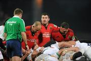 14 January 2012; Munster hooker Damien Varley, centre, with props BJ Botha, left, Wian du Preez, right, and referee Andrew Small during the game against Castres Olympique. Heineken Cup, Pool 1, Round 5, Munster v Castres Olympique, Thomond Park, Limerick. Picture credit: Matt Browne / SPORTSFILE