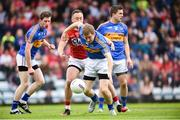 10 June 2017; Brian Fox of Tipperary in action against Paul Kerrigan of Cork during the Munster GAA Football Senior Championship Semi-Final match between Cork and Tipperary at Pairc Ui Rinn in Cork. Photo by Matt Browne/Sportsfile