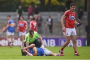 10 June 2017; Michael Quinlivan of Tipperary lies injured on the pitch as he is treated by team physio Ian Dowling before leaving the field injured during the Munster GAA Football Senior Championship Semi-Final match between Cork and Tipperary at Pairc Ui Rinn in Cork. Photo by Matt Browne/Sportsfile