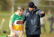 22 January 2012; The Offaly manager Ollie baker talks to Sean Ryan before the game. Bord na Mona Walsh Cup, Westmeath v Offaly, Coralstown Kinnegad GAA Club, Kinnegad, Co. Westmeath. Picture credit: Ray McManus / SPORTSFILE