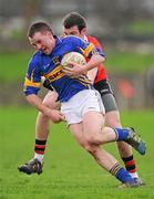 22 January 2012; Peter Acheson, Tipperary, in action against Padraig Lucey, UCC. McGrath Cup Football Semi-Final, Tipperary v University College Cork, Clonmel Sportsfield, Clonmel, Co. Tipperary. Picture credit: Stephen McCarthy / SPORTSFILE